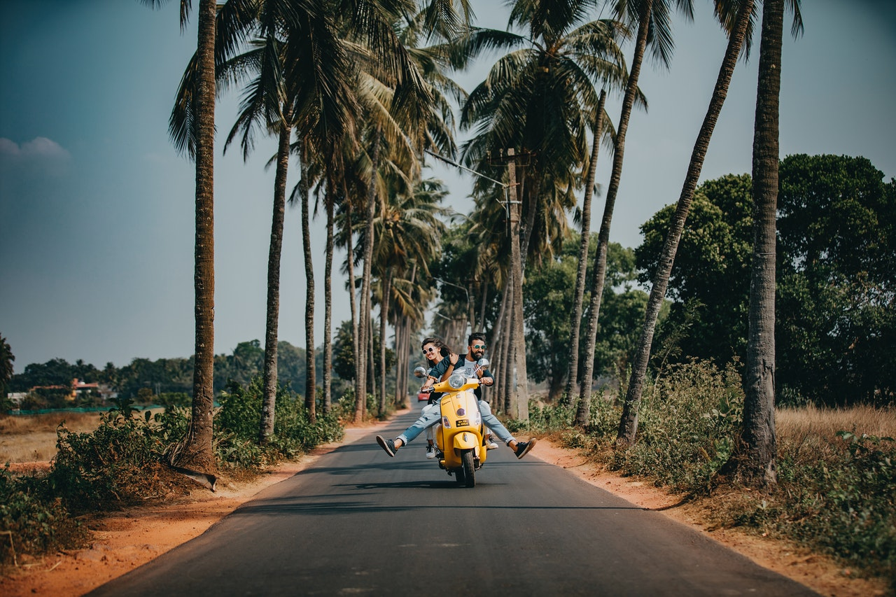 https://www.pexels.com/photo/woman-and-man-riding-on-motorcycle-2174656/